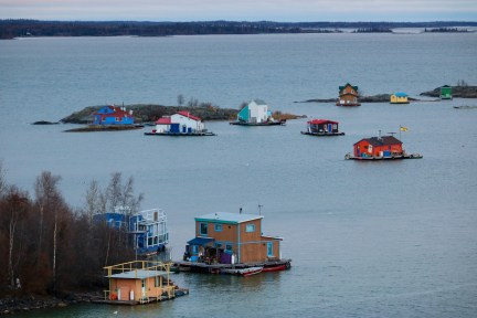 The iconic view of Yellowknife Bay (AKA 'Houseboat Bay') from the top of Pilot's Monument in Yellowknife's Old Town. These houseboaters are living off the grid in their floating homes in Great Slave Lake.