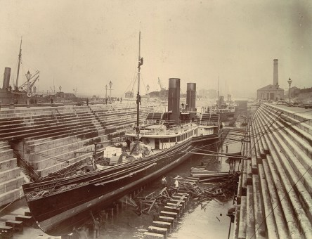 The paddle steamer RMS Columba under repair at Govan No 3 Graving Dock, looking east in May 1898. (Glasgow City Archives)