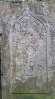 Memorial stone, in poor condition, dedicated to Lady Crawford's pet deer