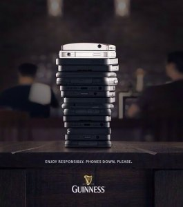 phones stacked to look like beer cup