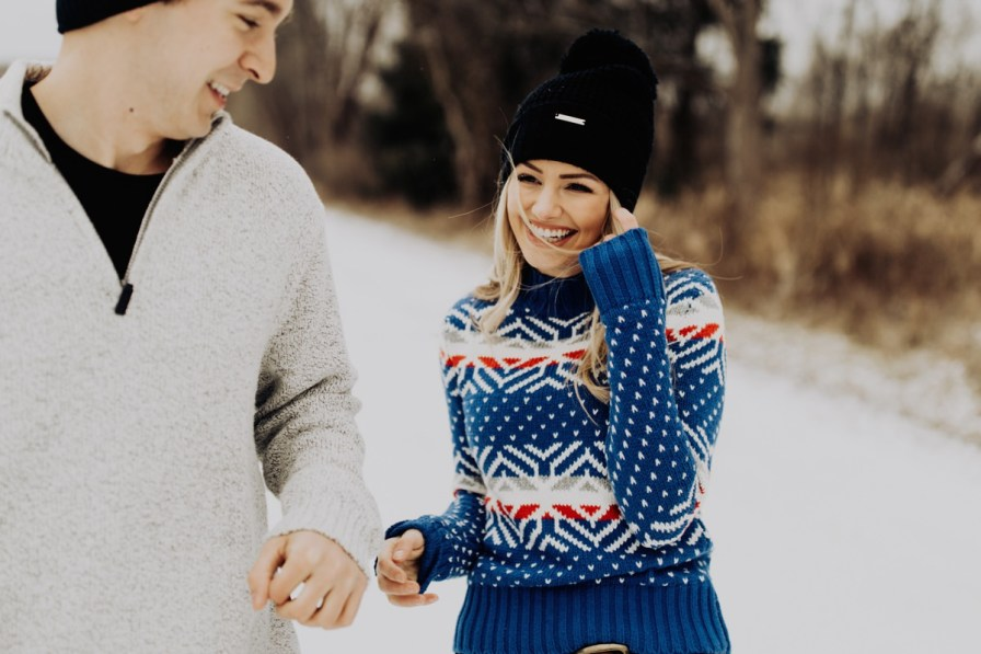 colorado winter engagement session girl with blue shirt on