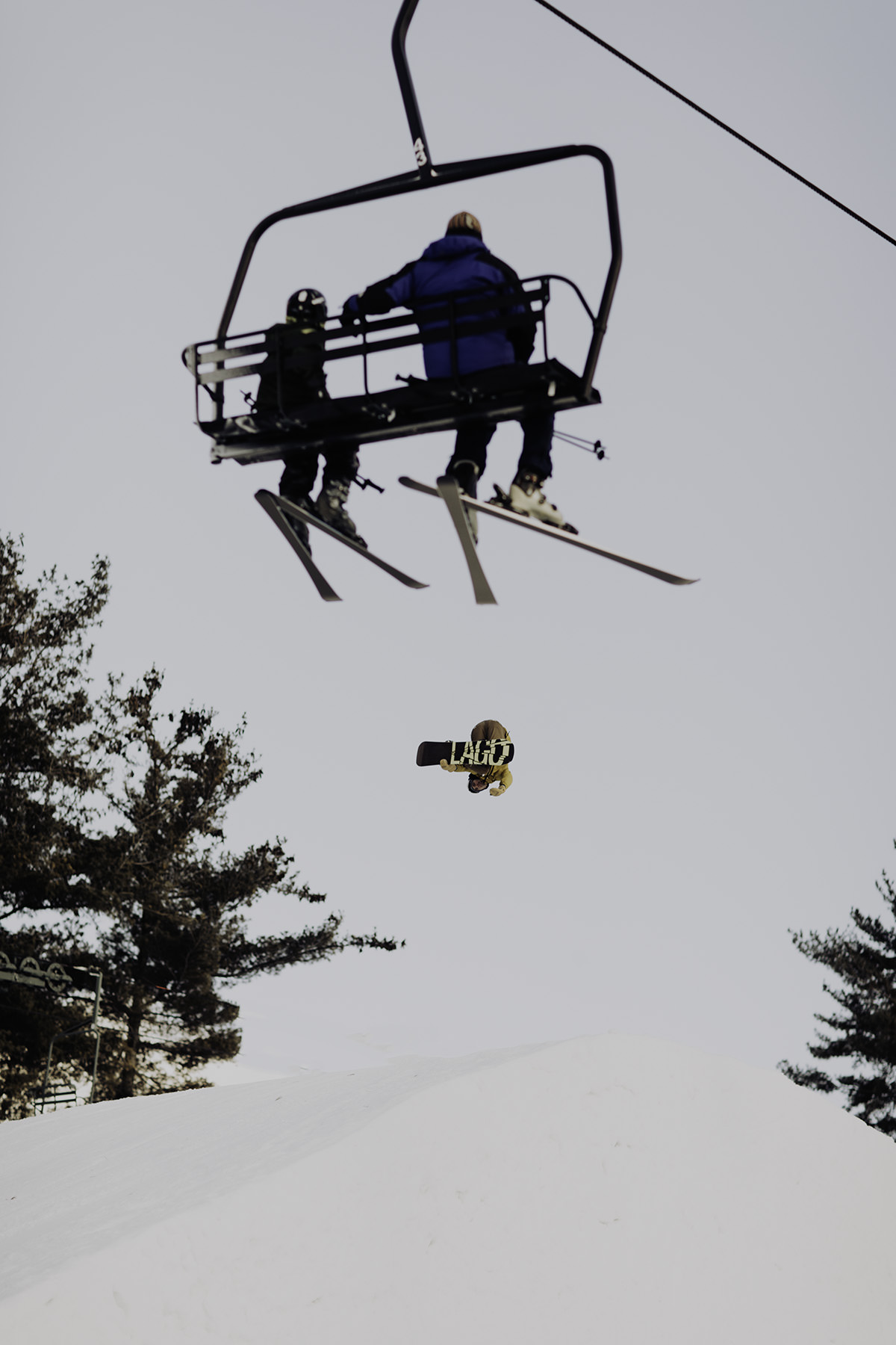 Adventure-Elopement-Photographer-Colorado-snowboarder-jumping-1