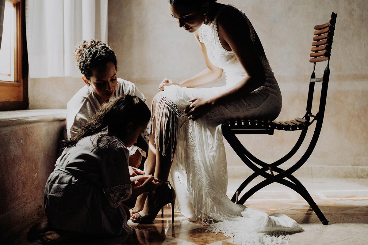 destination-elopement-photographer-bride-putting-dress-yucatan-mexico