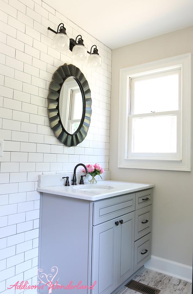 lakehouse bathroom gray cabinet white