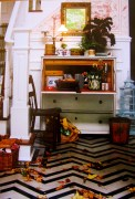Inspired by Hadley Parish a chevron painted floor with Gustavian bureau, birdcage and seat.