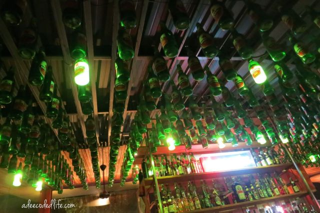 bar beer bottles ceiling