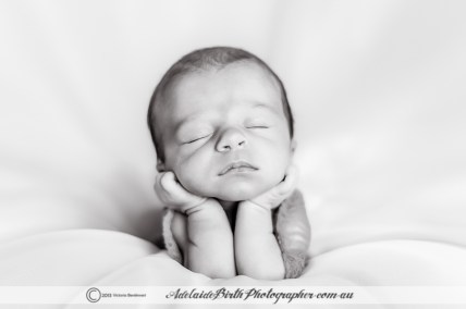 This image is a composite - babies should not be posed like this without hands on support!