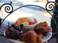 House baked pastries + fresh fruit salad