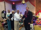 Pareshbai Lodhia felicitates Chief Inspector Rob Wilson