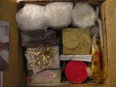 """Contents: 3 mason jars of yellow cake, gold napkins, gold plates, banner, gold table cloth, 3 forks, a glitter box filled with werther's candy (you're """"werth"""" your weight in gold), thank you cards, birthday candles, chocolate frosting, chicken and rice dinner, and a couple little notes from me. xo."""