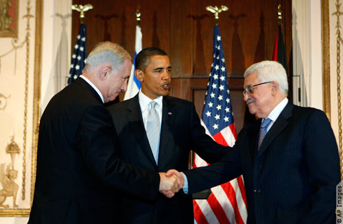 Israeli Prime Minister Benjamin Netanyahu (left) and Palestinian President Mahmoud Abbas shake hands in New York on September 22.  Obama is  said , No forward and bacward pattern, and no passing time, it should be serious peace this time.