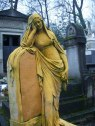 This sunny-yellow grave at Père Lachaise stood out among the gray.