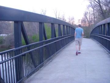 My boyfriend walks across a bridge.
