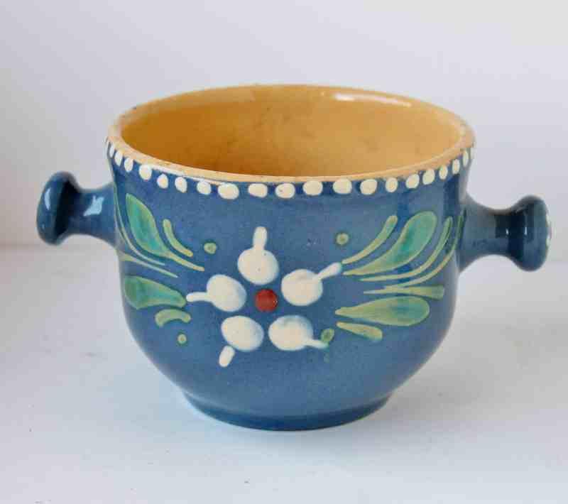 vintage blue crock with floral decoration
