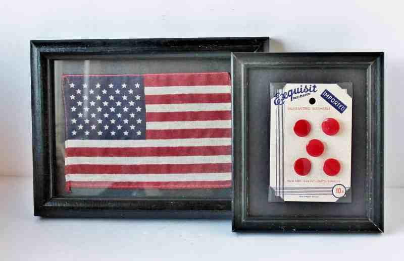 Framed vintage flag and vintage buttons in frame