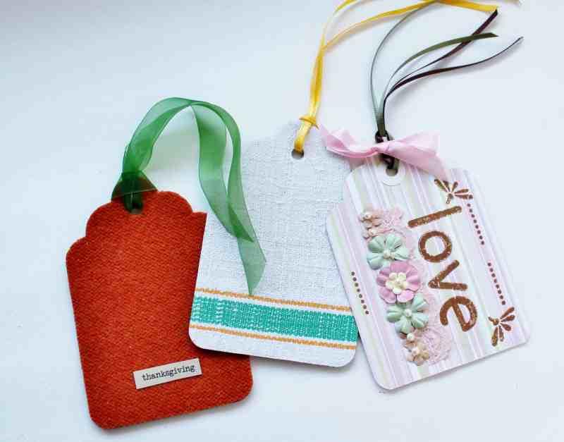 three handmade tags