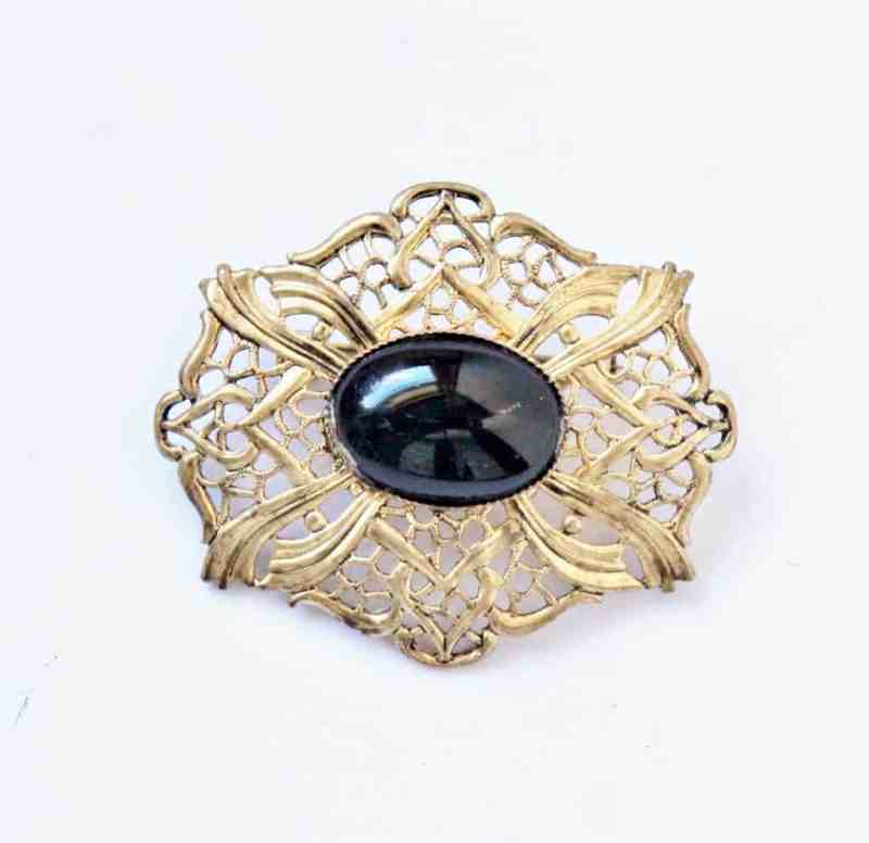 Vintage gold filigree pin with black cabachon