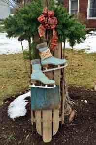 Christmas sled with blue skates and blue shovel