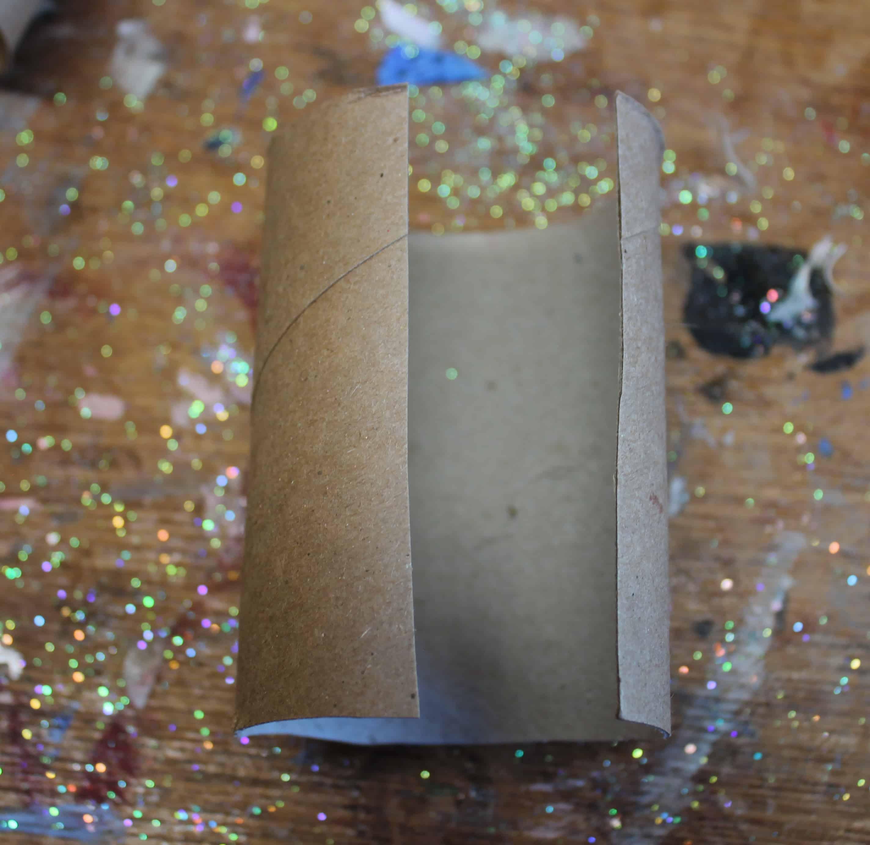 Cut toilet paper tube