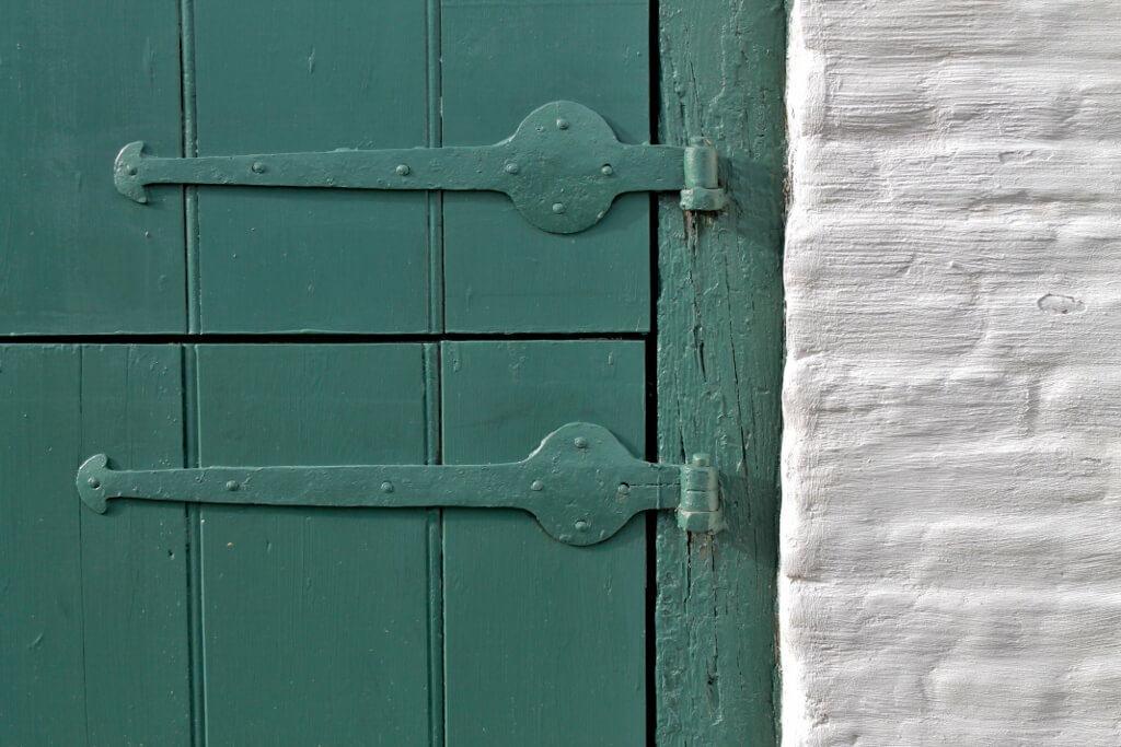 green-door-white-brick-1024x683