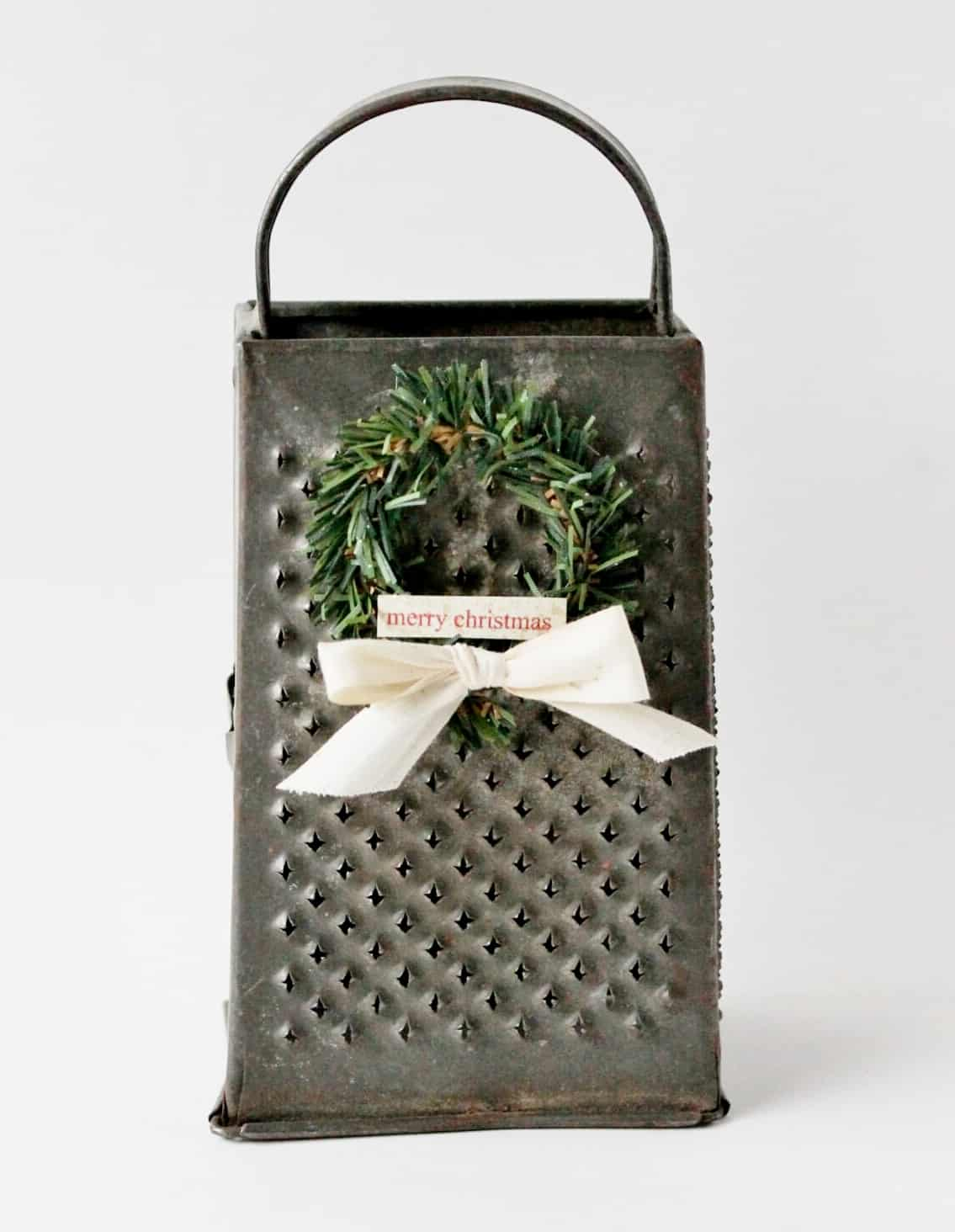 An old vintage grater decorated with a mini wreath