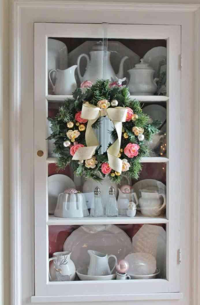 Vintage corner cupboard filled with vintage ironstone and vintage pink ornaments