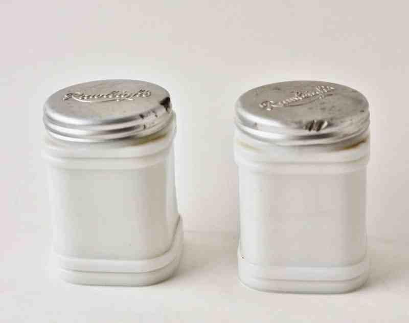 pair of vintage Rawleigh's milk glass jars