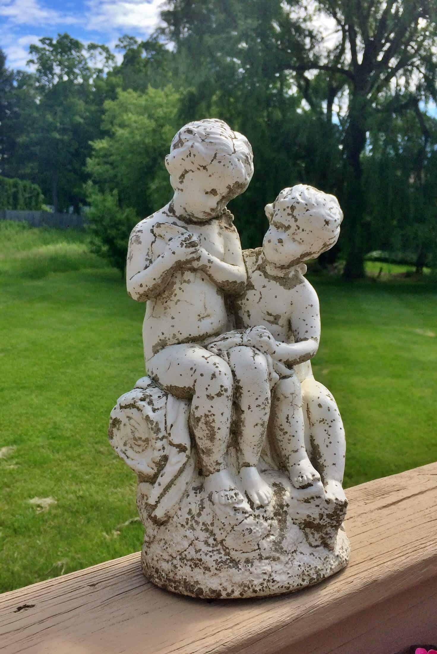 vintage concrete statue of cherubs