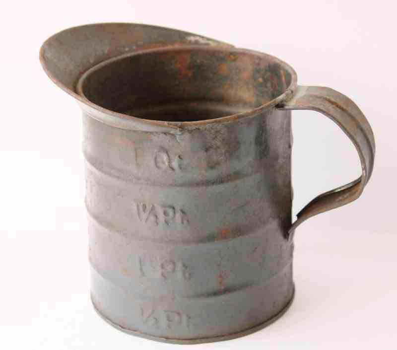 vintage metal measuring cu