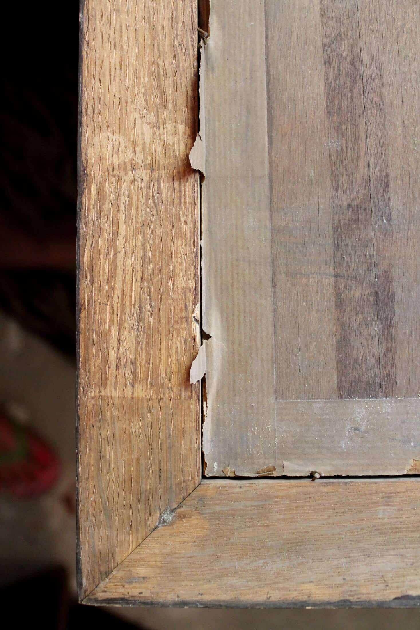 paper backing on antique wooden frame