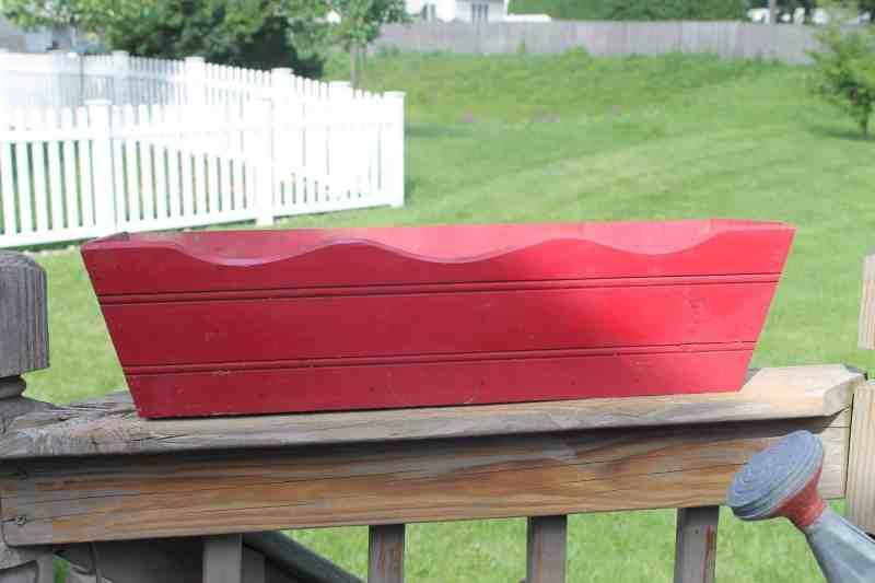 red wooden flower box