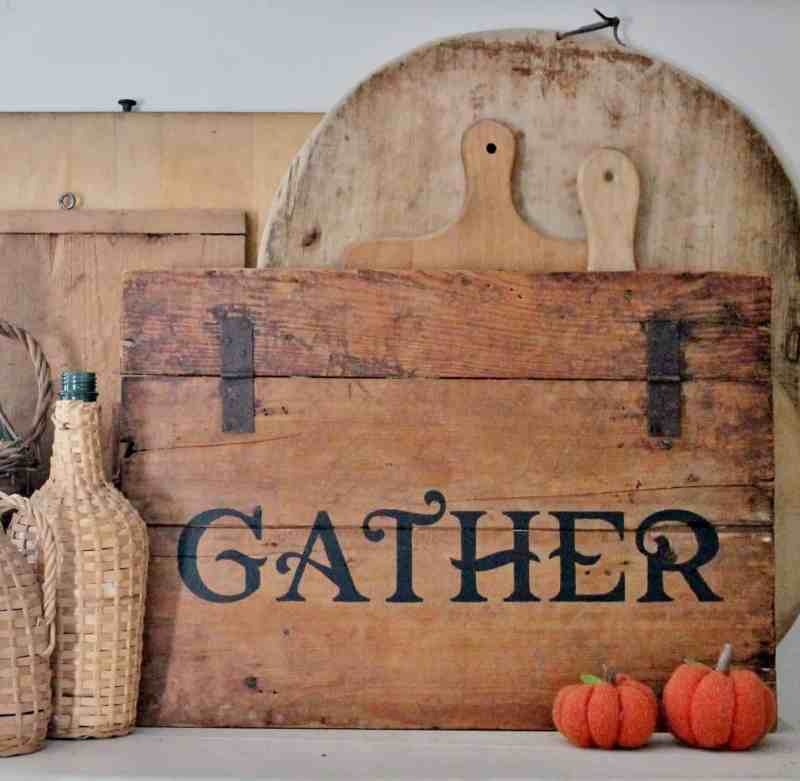 "Stenciled ""GATHER"" sign on antique crate lid"