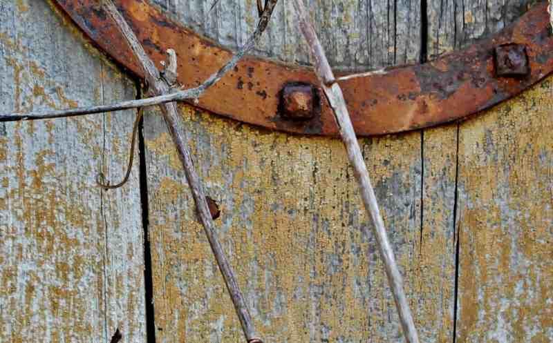 rusty metal strap on barn door