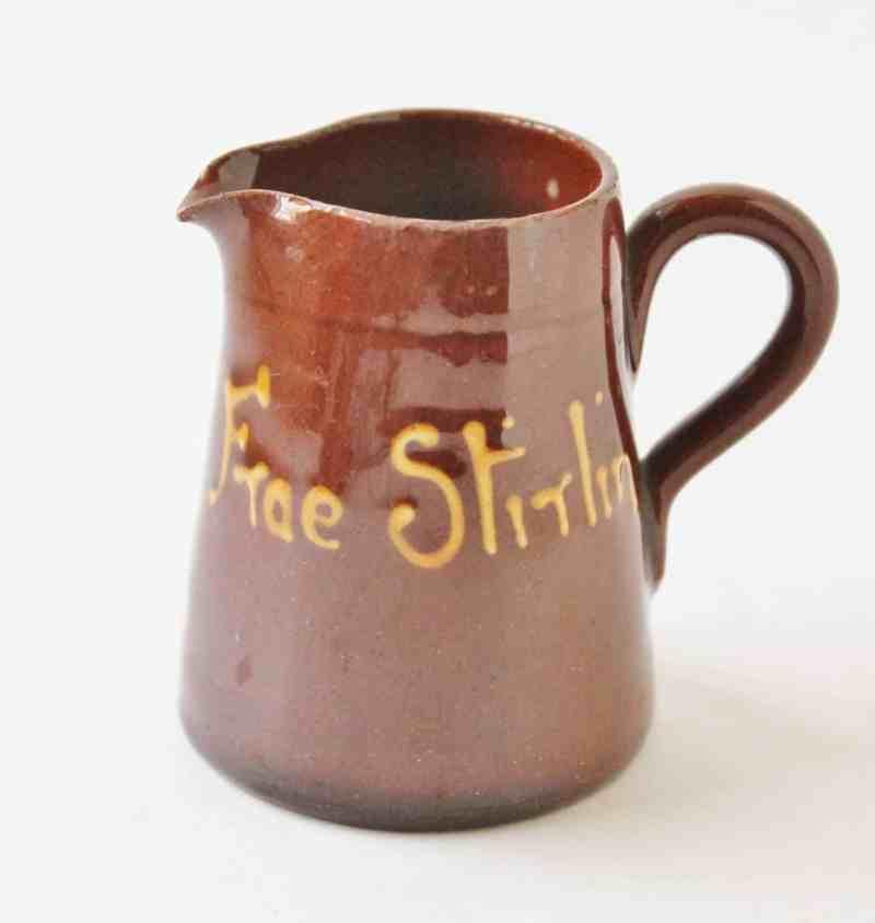 vintage redware with slip decoration pitcher
