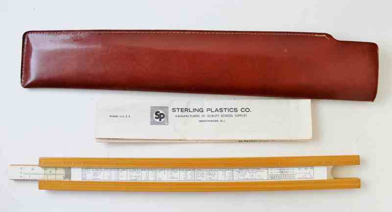 vintage slide rule with case