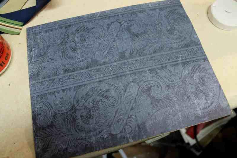 blue scrapbook paper glued to cardboard