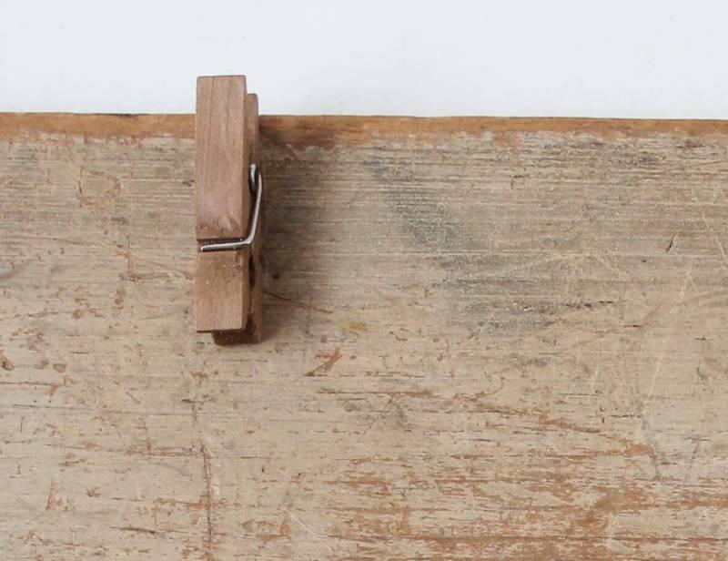 mini clothespin glued on vintage wood