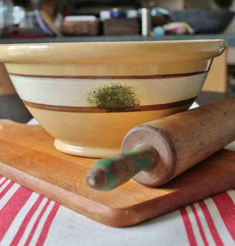 Yellow ware bowl, rolling pin, cutting board