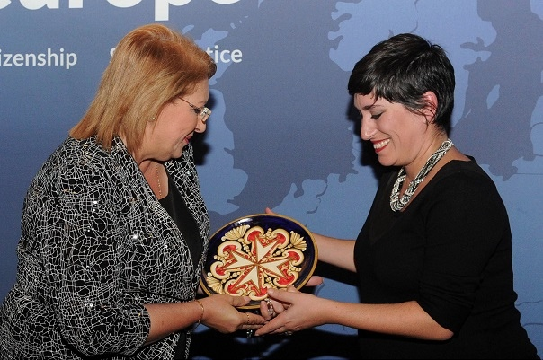 Carla (Legal Officer) accepting the away from the President of Malta.