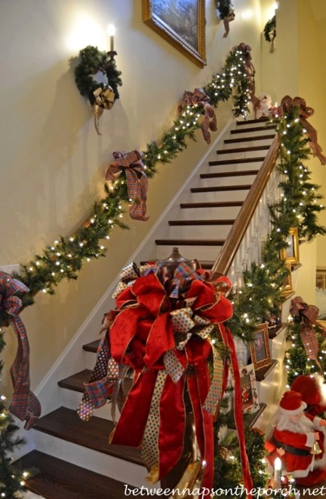 Stairway Decorated with Lit Garland and Ribbon