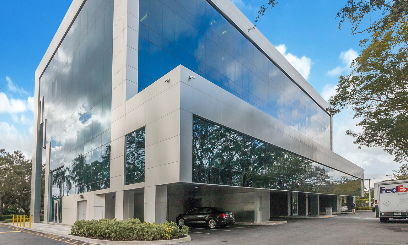 Modern office building with floor to ceiling windows exterior shot.