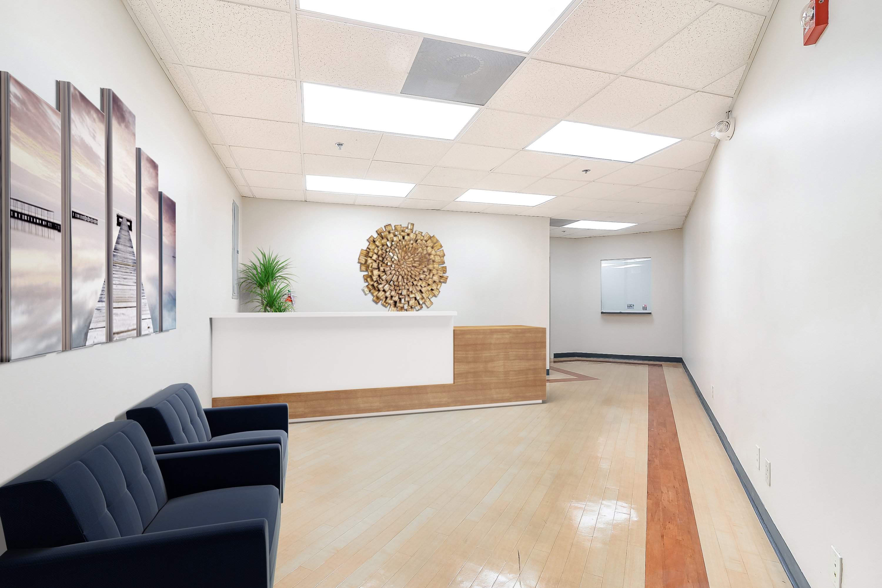 Medical reception office with wooden artwork.