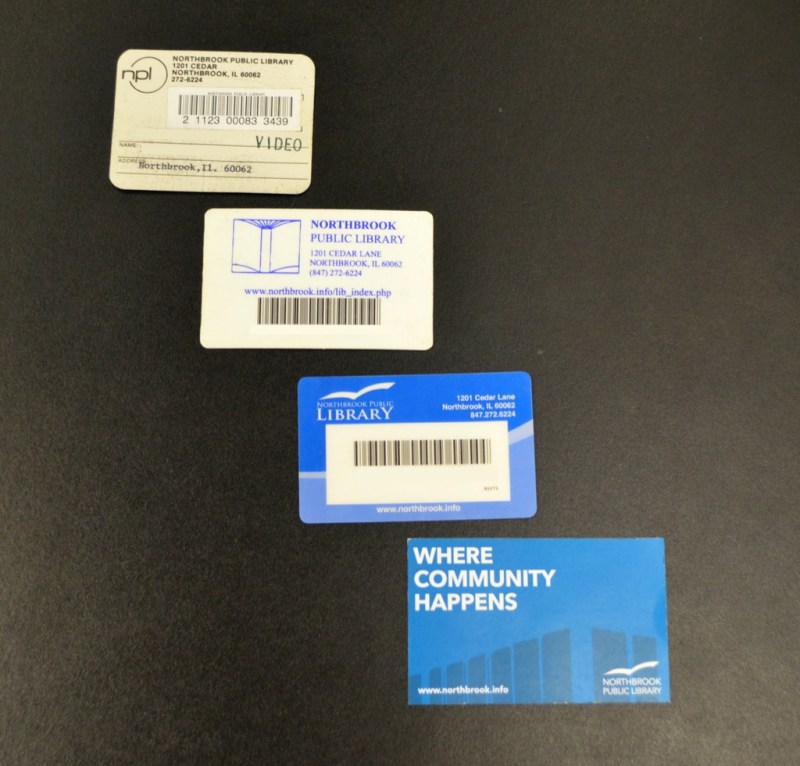 Image shows four library cards which show the changes the design has undergone over the years, with the new design at the bottom