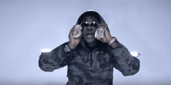 Medikal shares money and food on the streets of Nima
