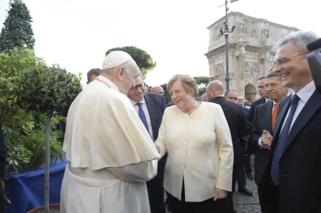 Pope Francis greets Angela Merkel after the closing ceremony. Vatican Media.
