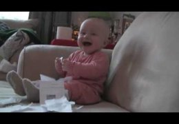 Baby laughing at ripping paper