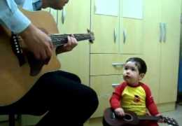 Little boy singing with his father