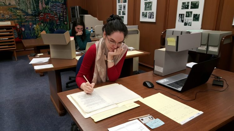 [Photo courtesy of Adriana Popa | Hard at work in the archives]