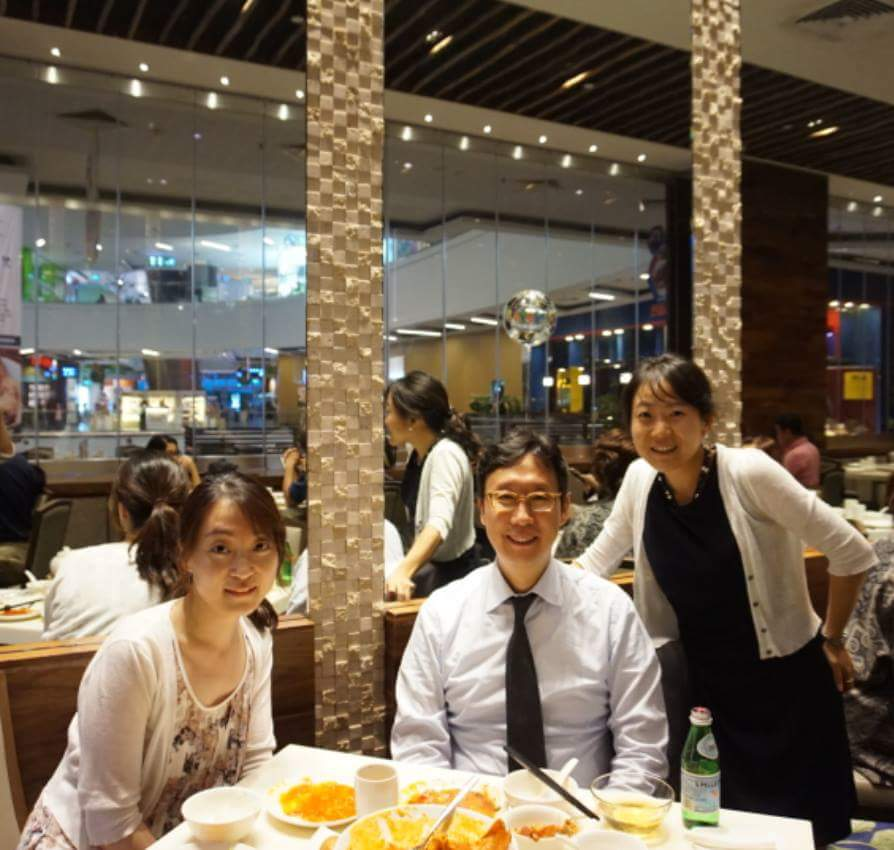 Rena Sung, her recommender, and another supervisor posing for a photo in a restaurant