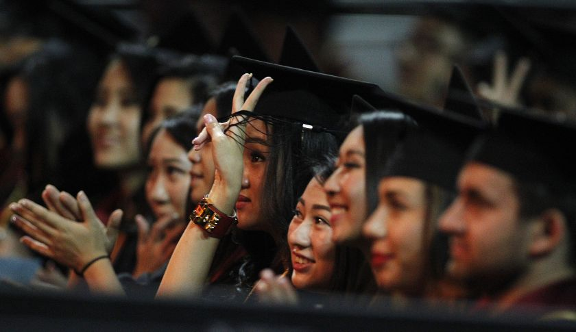 LOS ANGELES, CA.-MAY 16, 2014:  USC Marshall School of Business graduates cheer after listening to the commencement address by Tesla/SpaceX founder Elon Musk and student speaker Kiara Adams at USC's Marshall School of Business at the Galen Center Friday, May 16, 2014.  (Photo by Allen J. Schaben/Los Angeles Times via Getty Images)